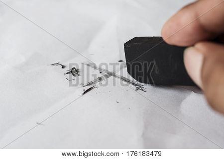 Eraser and error concept Hand with black eraser Mistake erase concept