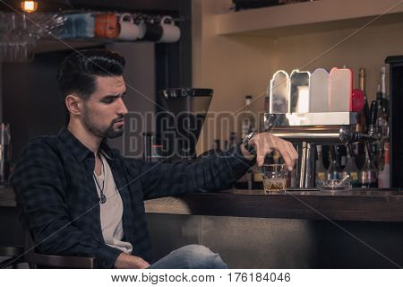 Young Man Sitting Bar Drinking