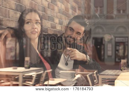 Young Woman Man Sitting Caffee Shop Window Reflection