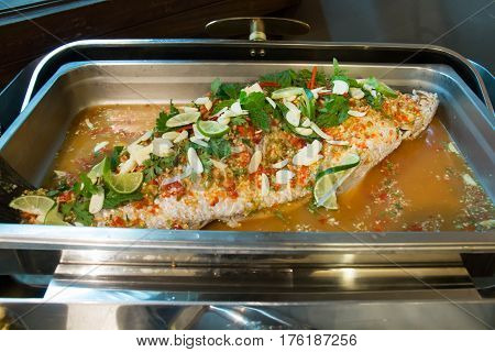 A Seabass Steamed with Lemon on top