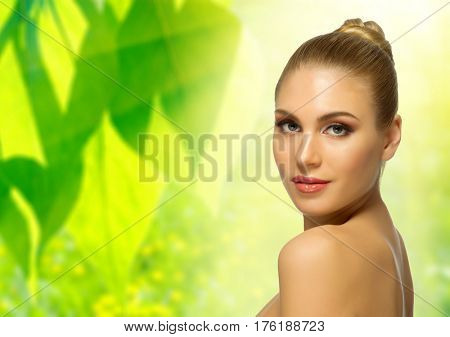 Young healthy woman on floral spring background