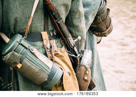 Parts of the German soldier's outfit Wehrmacht, flask, rifle and gas mask in the container