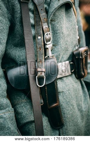 Leather holster for a pistol on the belt of a German soldier of the Second World War. Close-up