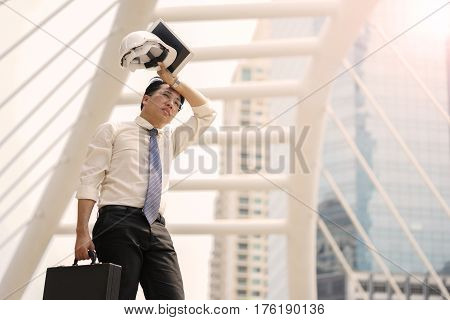 Tired or stressful businessman stop walking in the city after working with a building background.