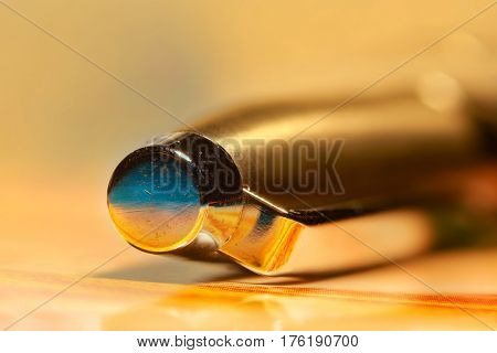 Extreme close up shot of golden pen