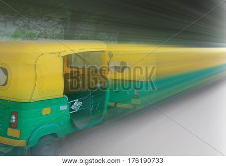 Tuktuk s parked in the stand in Bangalore ,India with motion blur