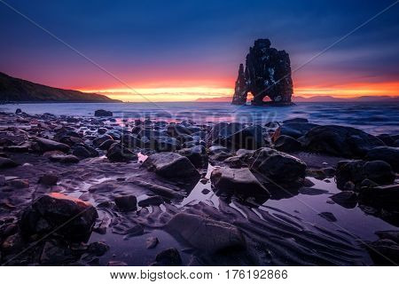 Wonderful dark sand after the tide. Dramatic and gorgeous scene. Location place Hvitserkur, Vatnsnes peninsula, island Iceland, Europe. Popular tourist attraction. Discover the world of beauty.