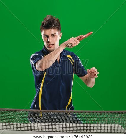 Concentrated young athletic man hit ping pong ball