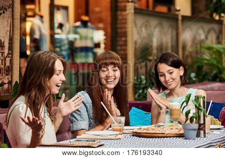 Excited happy best friends having party and eating pizza