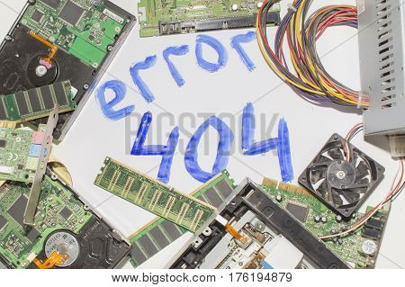 Electronic circuitry on a white background, top view, inscription error 404.