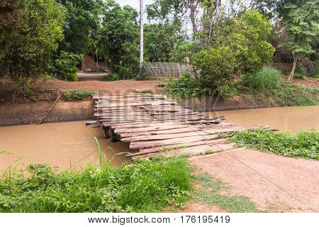 old Wood bridge in countryside , Thailand