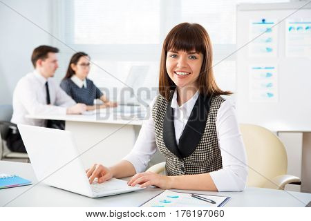 Businesswoman working with laptop in an office