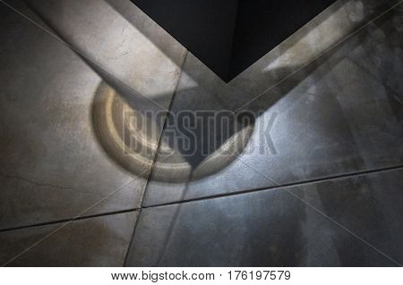 Amazing geometric shadows cast on a building's grooved cement floor, creating an abstract, moody experience for background.