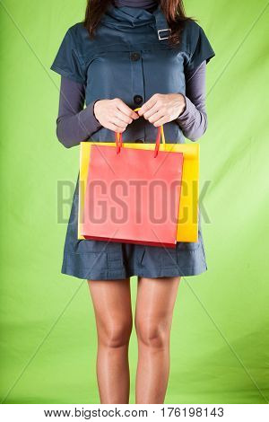 Woman With Shopping Bags On Green Background