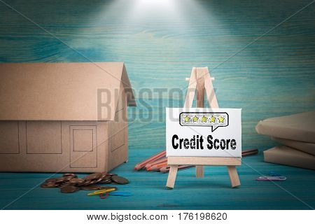 credit score. home model, money and a notice board under the sunlit.