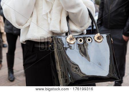 MILAN ITALY - FEBRUARY 26: Detail of bag outside Ferragamo fashion show during Milan Women's Fashion Week on FEBRUARY 26 2017 in Milan.