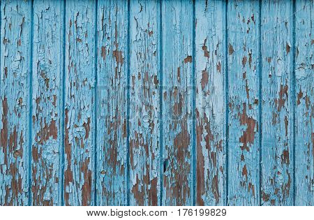 Blue vintage wood background with peeling paint vertical
