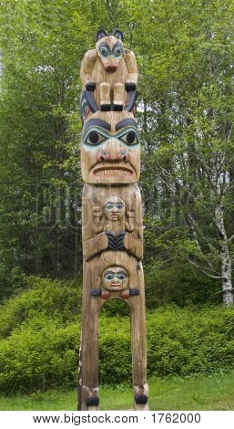 Alaskan totem pole of Saxman Nature Village in Ketchikan Alaska poster