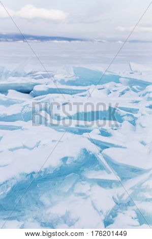 Turquoise ice floe. Winter landscape. Ice-drift of Baikal lake