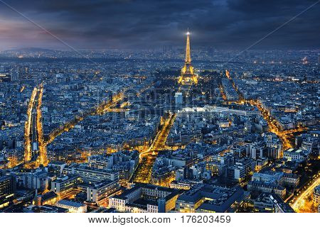 PARIS, FRANCE, January 29, 2017 : View of the Eiffel tower at night from the rooftop of the tour Montparnasse Paris.