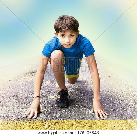 preteepreteen handsome boy in sport clothes and shoes prepare to have running event contest