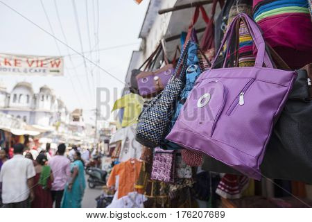 color pouch hanging display in shopfront at marketplace of Pushkar Rajasthan India
