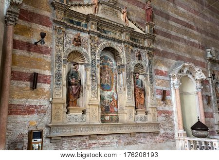 PADUA ITALY - MAY 3 2016: The Madonna with the child by Bonino da Campione in the church of The Eremitani (Chiesa degli Eremitani) on the tomb of Umberto da Carrara. Padua. Italy