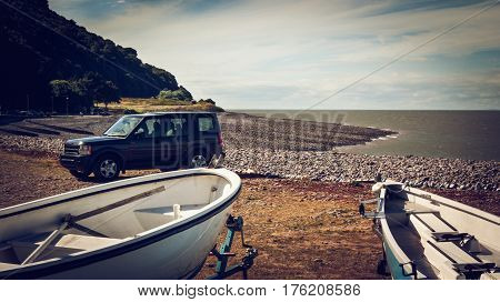 Boats in Shingle beach Minehead Somerset UK.