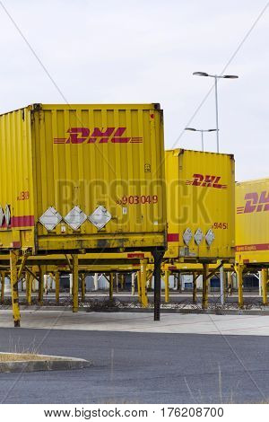 Dobroviz, Czech Republic - March 12: Dhl Shipping Containers In Front Of Amazon Logistics Building O