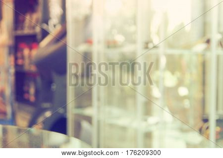 Blur decor of customer service car part showroom background concept Photo in office has product shelf color retro tone.