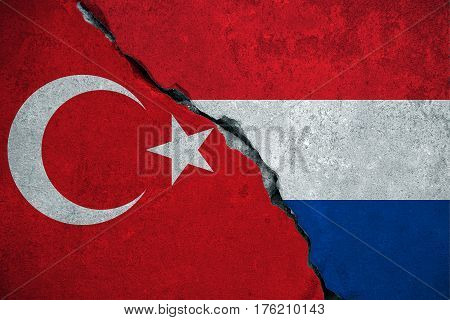 red turkey flag on broken damage brick wall and half holland white red blue color flag relationship crisis politics between nederland and turkey concept