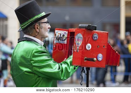 Badajoz Spain - February 28 2017: Unidentified cameraman working at Carnival parade of comparsas at Badajoz City on February 7 2016. This is one of the best carnivals in Spain especially highlighting massive participation of people