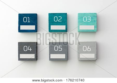 Index, menu or cover abstract background, consisting of six colored cubes with numbers and white blank space, on natural white background, with highlight on upper left. Blue, light blue to grey.