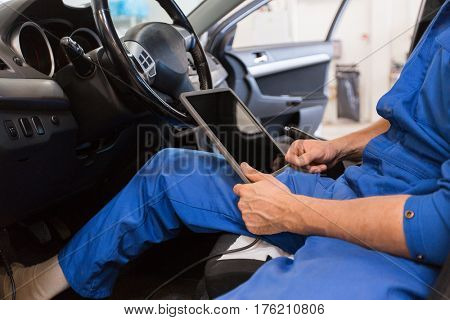 car service, repair, technology, maintenance and people concept - mechanic man with tablet pc computer making system diagnostic at workshop