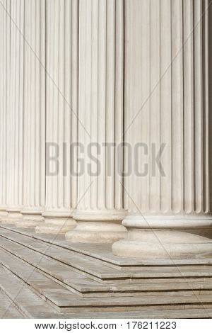 vertical perspective view close up of classical building marble white columns with stairs