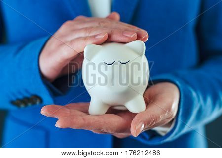 Businesswoman cuddles piggy coin bank responsible budgeting and money saving