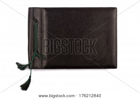 top view of vintage photo black album cover with rope bindings isolated on white background