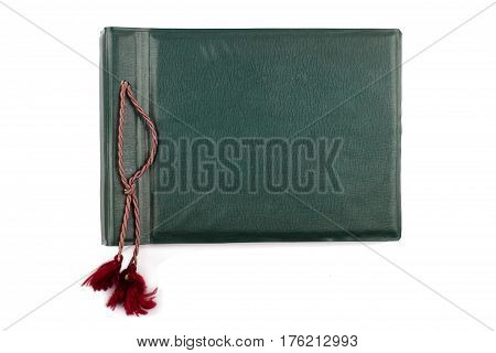 top view of vintage photo green album cover with rope bindings isolated on white background