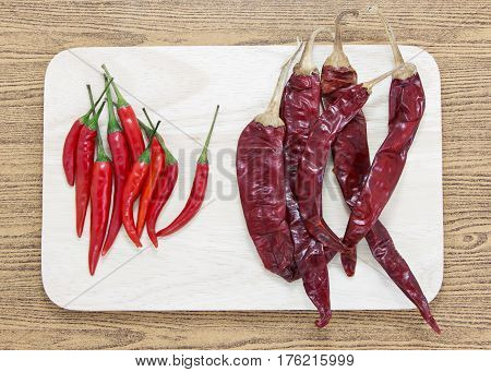 fresh chili and dried chili on chopping board