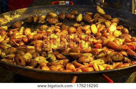 Fried potatoes in a large frying pan