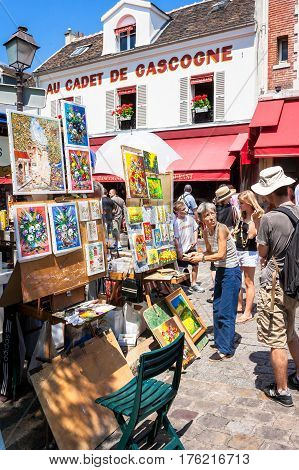Paris France - June 30 2006: Artists exposing their works to the tourists in open air at Tertre square (Place du Tertre) in Montmartre.