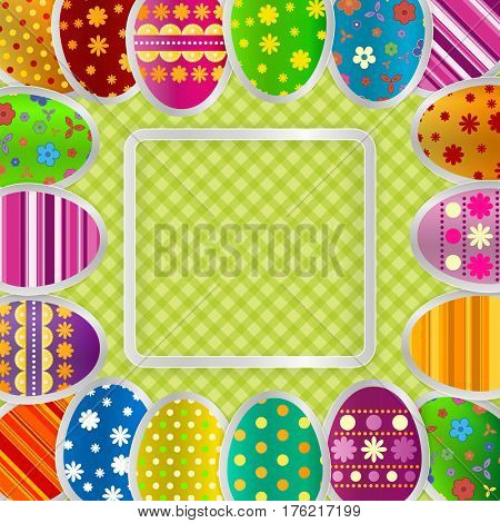 Spring greeting background with Easter eggs. Festive paper images of eggs on a square light frame. Country style green tablecloth. Greetings card with the Happy Easter!