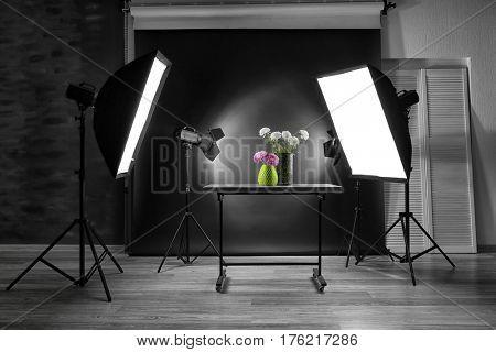 Interior of professional photo studio with flowers