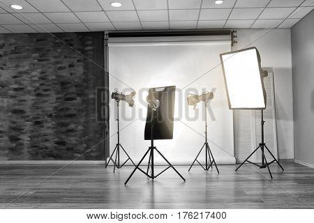 Empty photo studio with lighting equipment