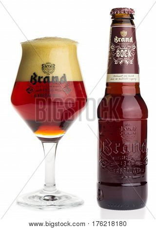 GRONINGEN, NETHERLANDS - MARCH 13, 2017: Bottle and glass of Dutch Brand Dubbel Bock beer isolated on a white background
