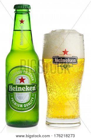 GRONINGEN, NETHERLANDS - MARCH 13, 2017: Bottle and glass of Heineken Pilsener beer isolated on a white background