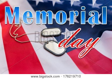 military forces, patriotism and national holidays concept - memorial day words over american flag and soldiers badges