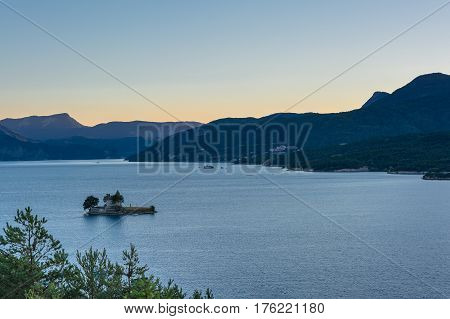 Beautiful view of the Lac de Serre Poncon in the French Alps on a lukewarm summer evening.