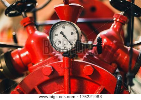 Pressure meter of an old fire engine.