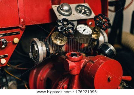Pressure meters of an old fire engine.